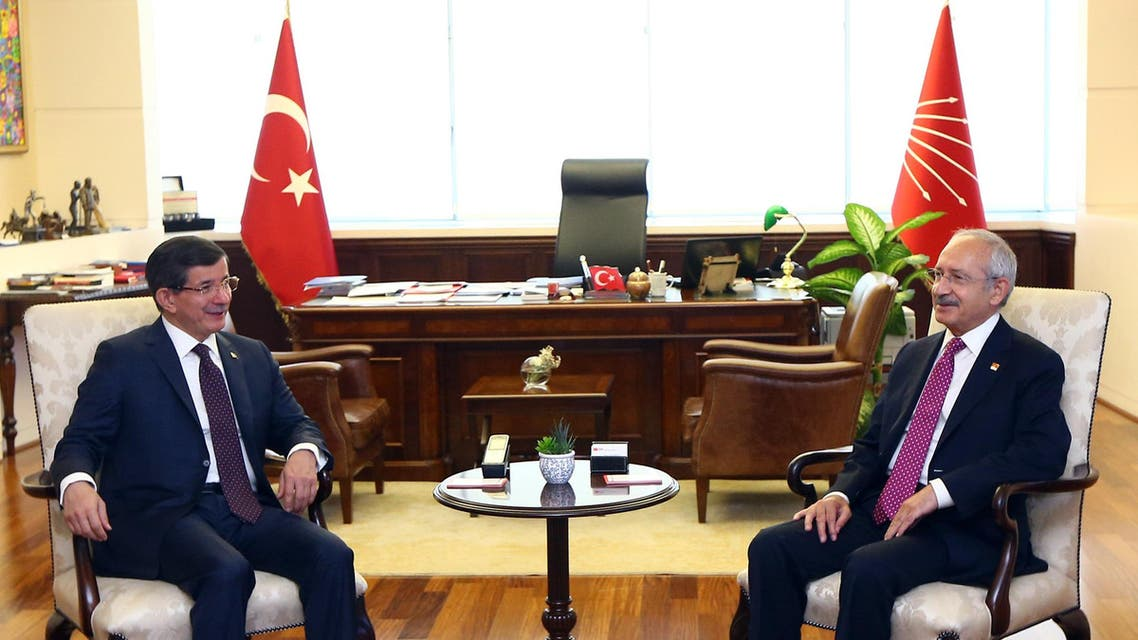 Turkish Prime Minister and leader of Justice and Development Party Ahmet Davutoglu, left, and the leader of the main opposition Republican People's Party, CHP, Kemal Kilicdaroglu during a meeting in Ankara, Turkey, Monday, July 13. 2015. Davutoglu has begun a first round of talks on forming a coalition government by meeting officials of Turkey's secularist party, CHP, his ruling Islamic-rooted party's arch-foe. Davutoglu met with Kilicdaroglu on Monday, a month after Turkey's June 7 election left his party short of a majority, forcing it to seek a coalition alliance.(AP Photo)