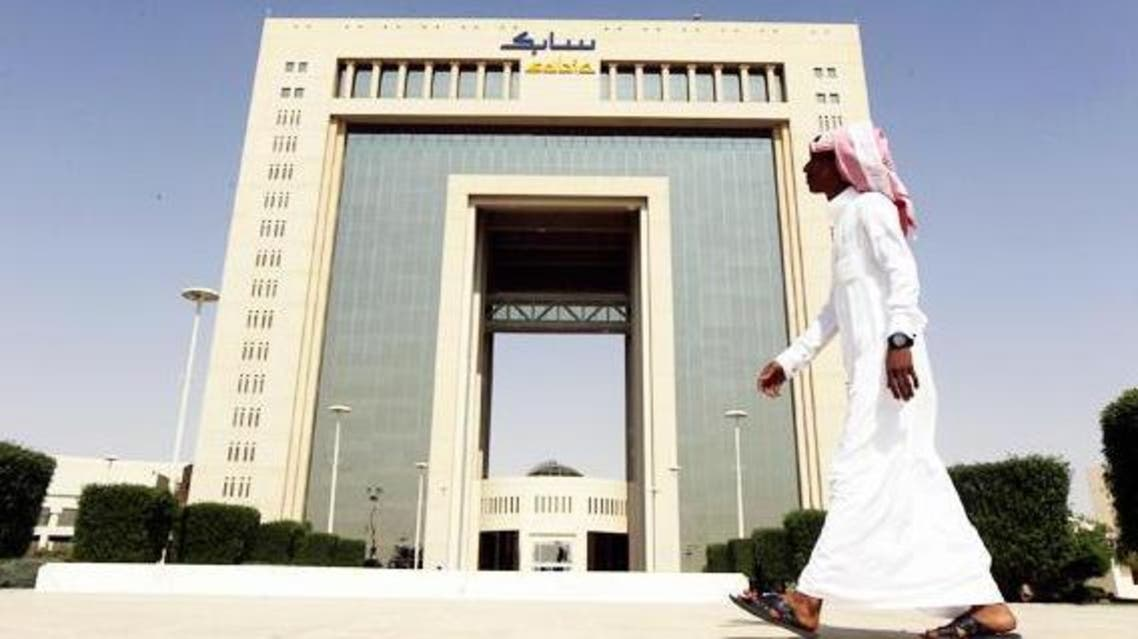 A man walks past the headquarters of Saudi Basic Industries Corp (SABIC) in Riyadh, in this Oct. 27, 2013 photo. (Reuters)