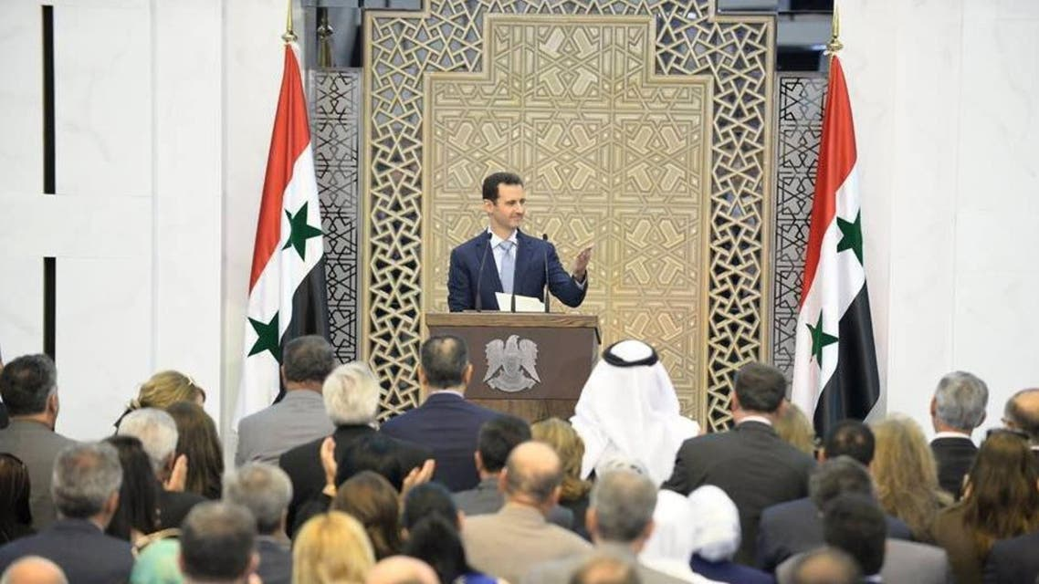 A handout picture released on the official Facebook page of the Syrian Presidency shows President Bashar al-Assad giving a speech during a meeting with members of public organizations, vocational syndicates; and chambers of industry, trade, agriculture and tourism in the capital, Damascus, on July 26, 2015.  AFP