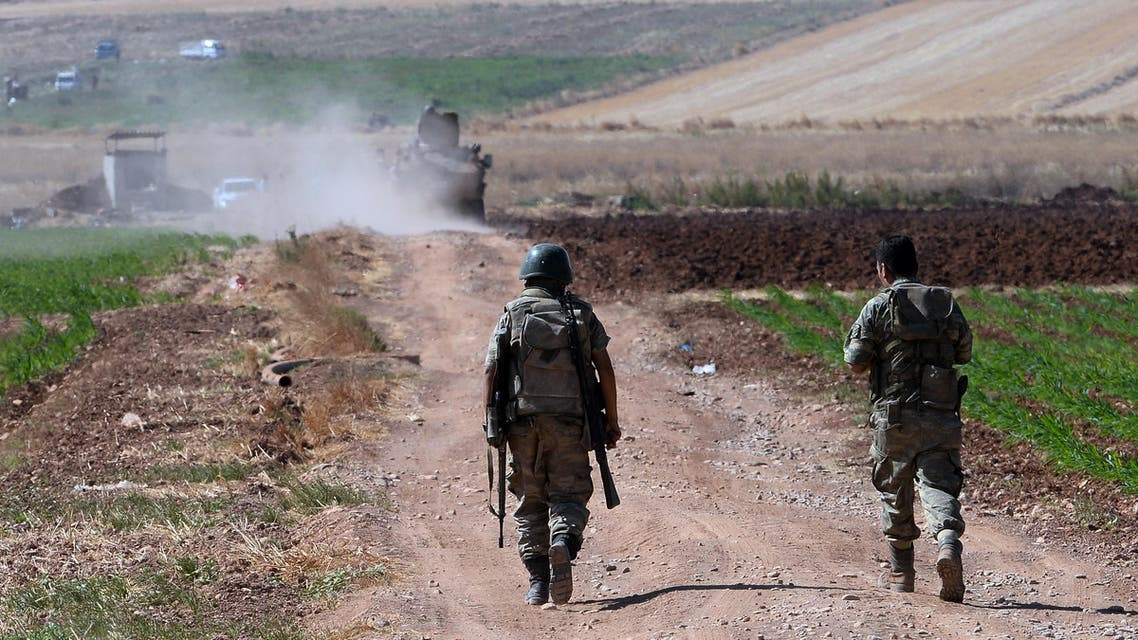 Turkish soldiers patrol near the border with Syria, ouside the village of Elbeyli, east of the town of Kilis, southeastern Turkey, Friday, July 24, 2015. AP Turkish soldiers backs