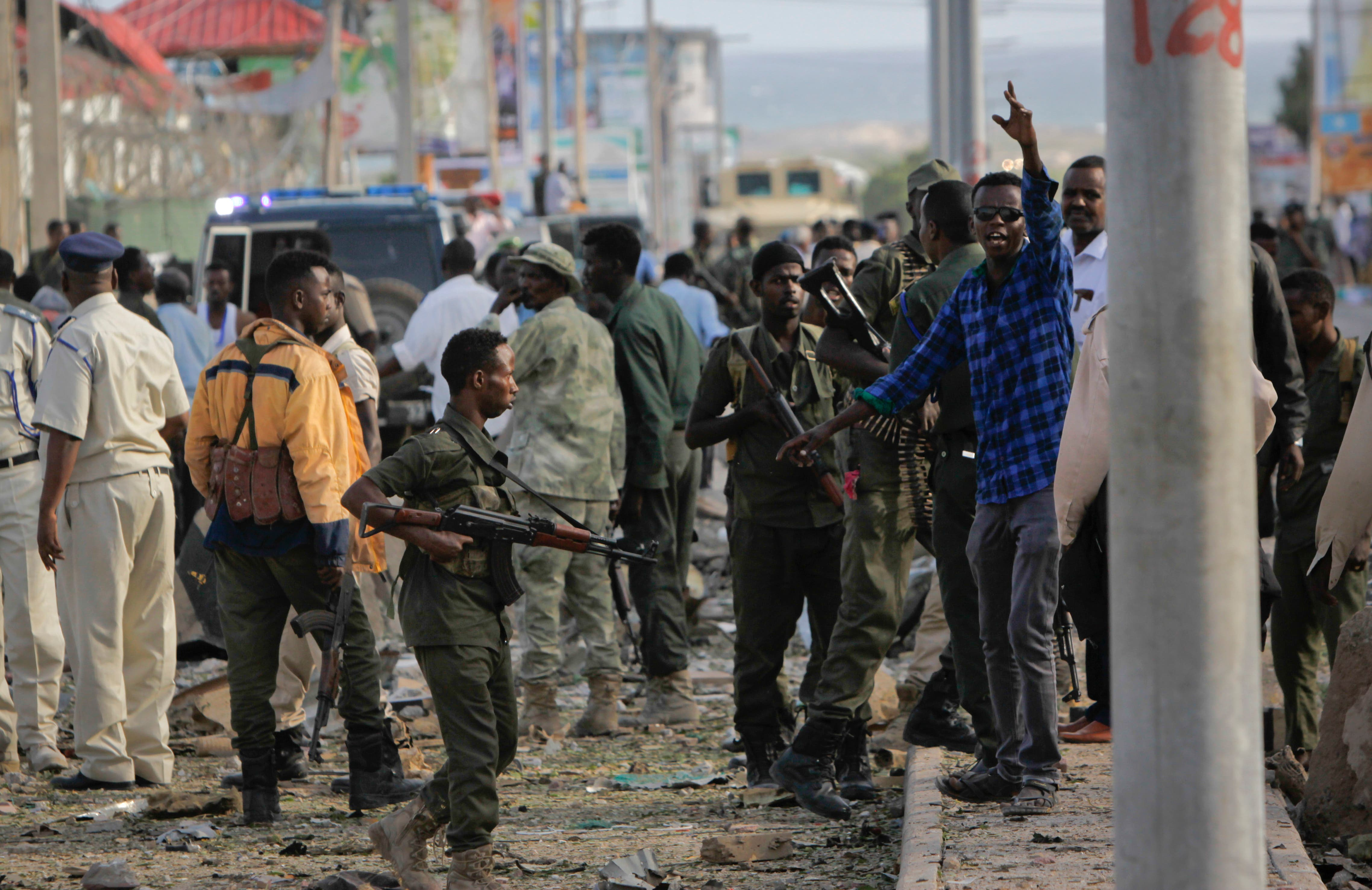 Security forces gather at the scene following a suicide car bomb attack in the capital Mogadishu, Somalia, Sunday, July 26, 2015. (AP)