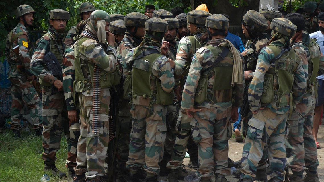 Indian army listen instructions from a higher commander during a fight in the town of Dinanaga, in the northern state of Punjab, India, Monday, July 27, 2015. AP