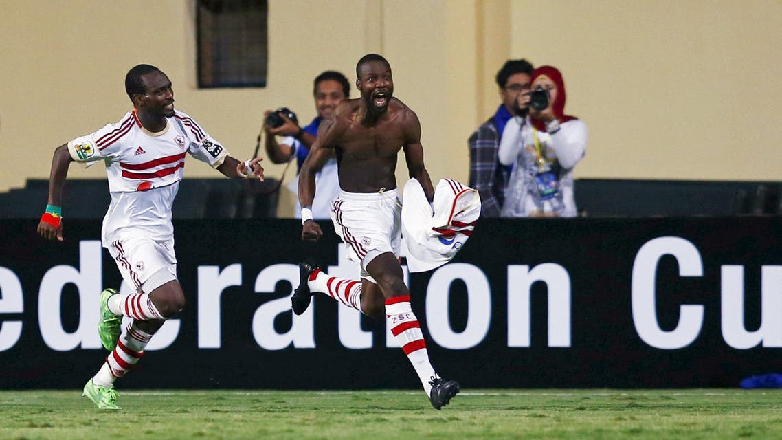 Abdallah Cisse of Egypt's Zamalek celebrates a goal with team mate Mohamed Koffi (L) during their CAF Confederation Cup soccer match against Tunisia's CS Sfaxien at Petro Sport stadium in Cairo, Egypt, June 27, 2015. AP
