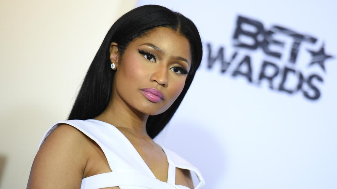 Nicki Minaj, winner of viewers choice and best female hip hop artist awards, poses in the press room at the BET Awards at the Microsoft Theater on Sunday, June 28, 2015, in Los Angeles. (Photo by Richard Shotwell/Invision/AP)