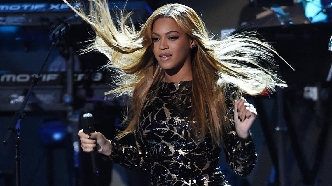 """In this Feb. 10, 2015 file photo, Beyonce performs at """"Stevie Wonder: Songs in the Key of Life - An All-Star Grammy Salute,"""" at the Nokia Theatre L.A. Live in Los Angeles. Madonna, Rihanna, Beyonce and Jay Z are among the A-List musicians who are co-owners of the streaming service Tidal. Kanye West, Daft Punk, Alicia Keys, Jack White and Nicki Minaj also announced that they are co-owners of the streaming service at an event Monday, March 30, 2015, in New York City. (Photo by Chris Pizzello/Invision/AP, File)"""