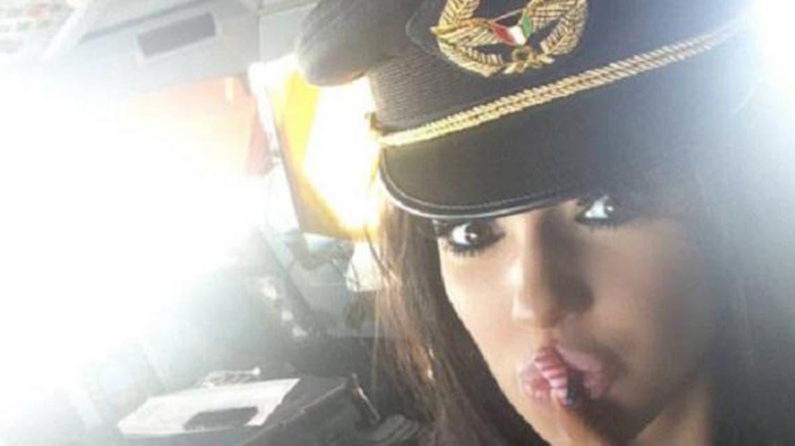 Chloe Khan Mafia inside a Kuwaiti airplane