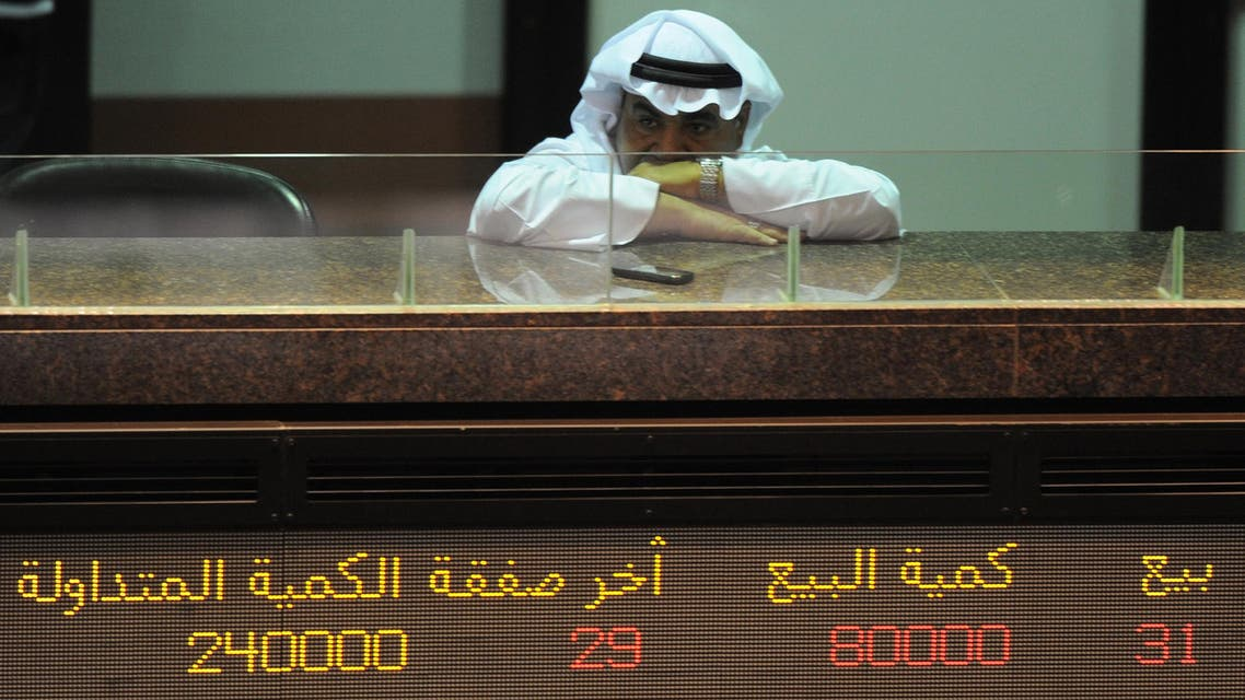A Kuwaiti trader follows the downturn of shares at Kuwait Stock Exchange in Kuwait City Monday, July 18, 2011. The KSE Market Index on Monday closed 1.57% lower at 5,973.1 points. As the debt clock is ticking in Europe and the US, financials dragged the bourse down. National Bank of Kuwait (NBK) dived 5.76% to KD1.040. Gulf Bank of Kuwait declined 3.8% to KD0.500. Sokouk Holding surged 14.3% and closed as a top gainer at KD0.020. (AP Photo/Gustavo Ferrari)