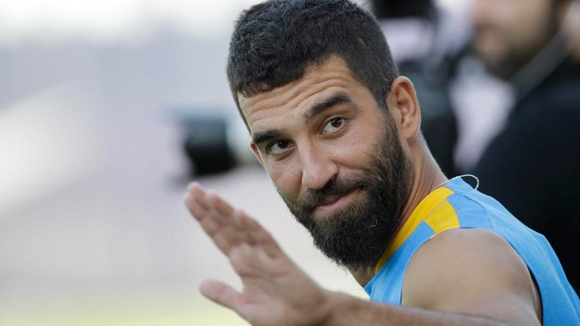 APFC Barcelona's Arda Turan gestures during the first training session of the 2015-2016 football season at the Sports Center FC Barcelona Joan Gamper in the San Joan Despi, Spain, Monday, July 13, 2015.