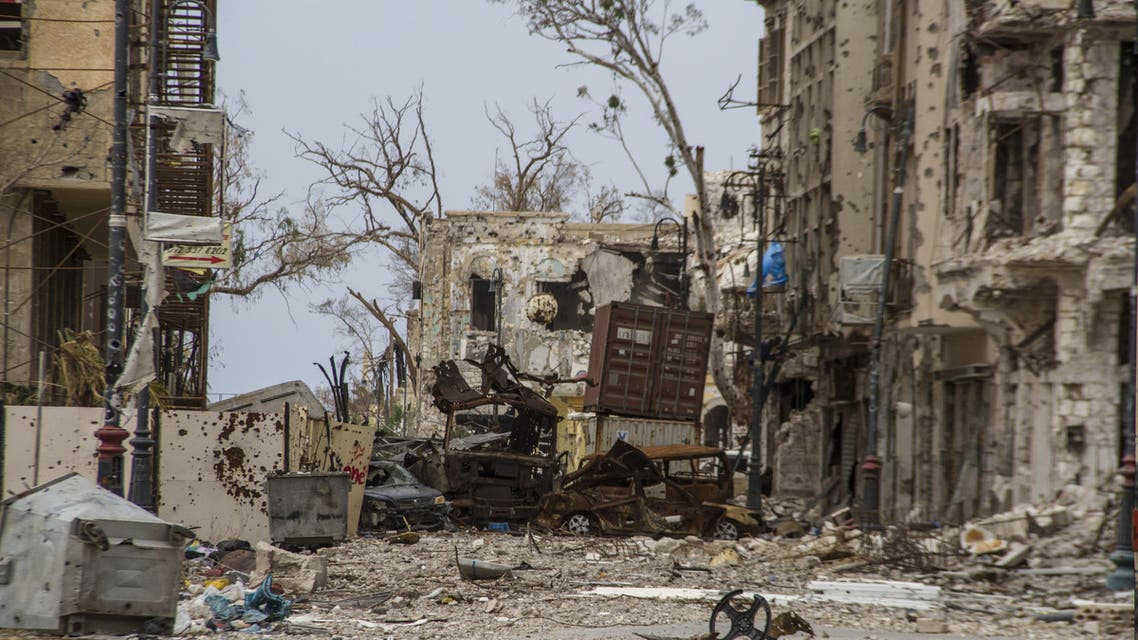 In this photo taken on March 24, 2015, damaged homes line in a street in Benghazi, Libya. Destruction has permeated the North African country since the civil war ousted Moammar Gadhafi four years ago. For Benghazi, the past year was the worst. (AP Photo/Mohamed Salama)