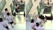 Video: Toddler's mother dies in freak escalator accident