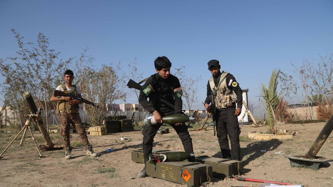 In this Sunday, March 15, 2015, file photo, young Shiite volunteer militia members prepare to attack Islamic State fighters in Tikrit, north of Baghdad, Iraq. AP