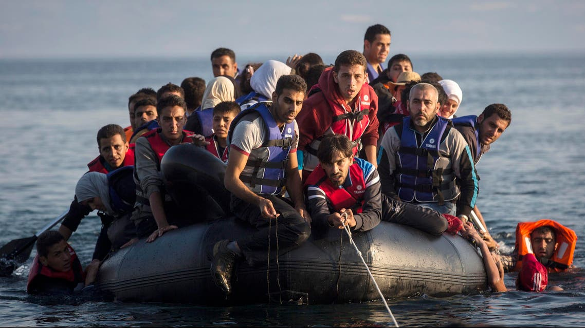 Migrants from Syria and Afghanistan arrive on an overcrowded dinghy from the Turkish coasts to the Greek island of Lesbos, Monday, July 27, 2015. Nearly 50,000 people have illegally entered the country this year, mostly Syrian refugees who risk the sea crossing from Turkey in dangerous, overcrowded boats. From Greece, most try to continue north through the Balkans to more affluent European countries such as Germany. (AP Photo/Santi Palacios)
