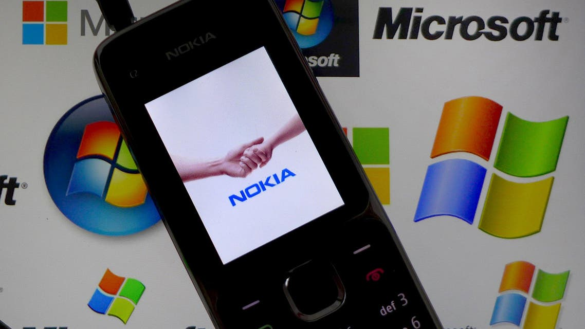A Nokia mobile phone lies on a tablet computer showing logos of Microsoft in this file illustration picture taken in Frankfurt, Germany, November 18, 2013. Reuters