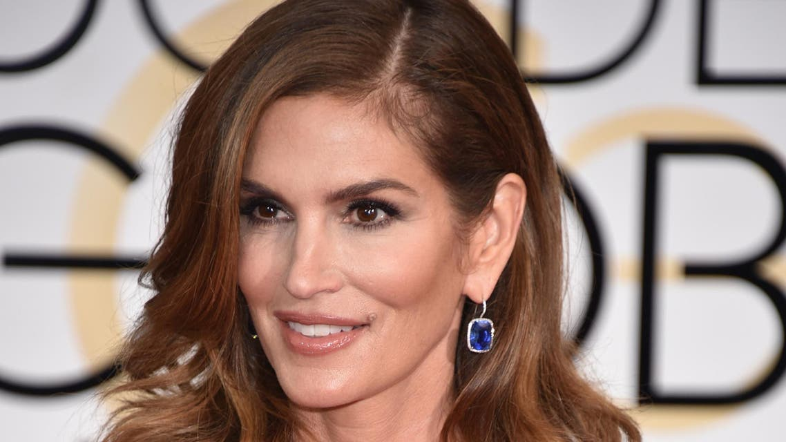 Cindy Crawford arrives at the 72nd annual Golden Globe Awards at the Beverly Hilton Hotel on Sunday, Jan. 11, 2015, in Beverly Hills, Calif. (Photo by John Shearer/Invision/AP)