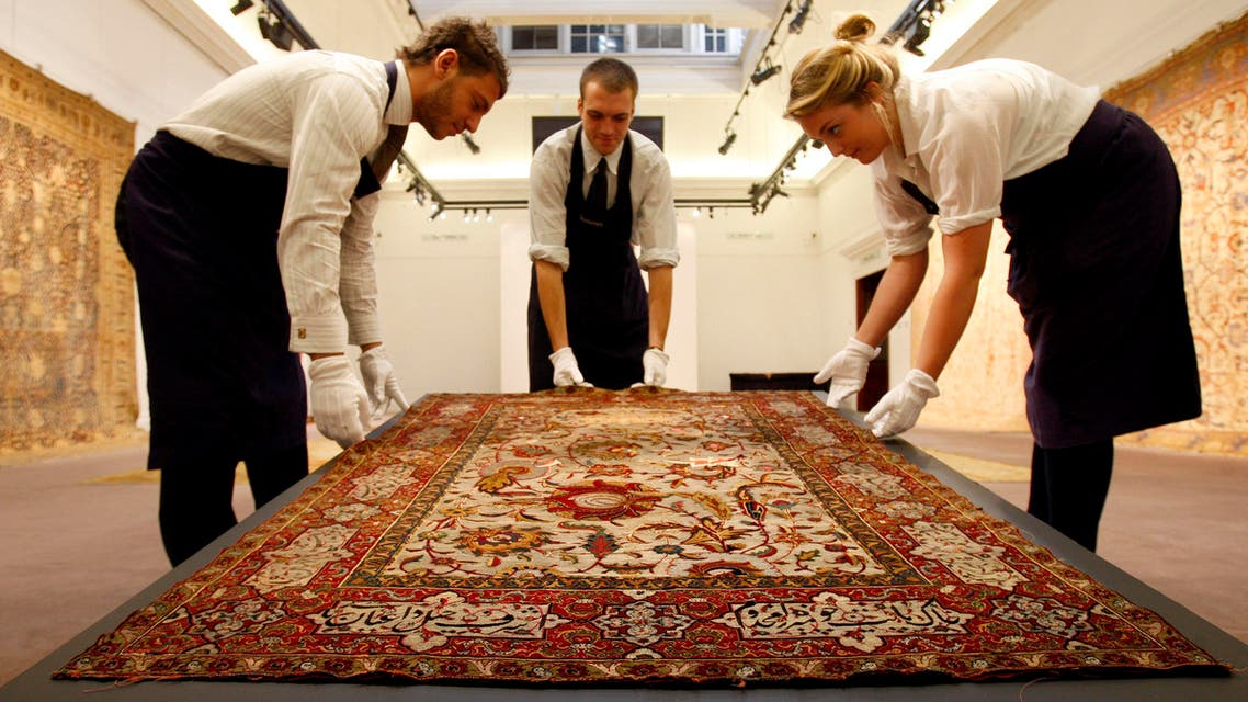 A Safavid silk, wool and metal thread prayer rug is displayed at Sotheby's auction rooms in London, Friday, Oct. 2, 2009. The rug, estimated at 80,000- 120,000 pounds (US$127,943-US$191,915) is one of the items for auction in the Arts of the Islamic World sale on Oct. 7, 2009. (AP Photo/Kirsty Wigglesworth)
