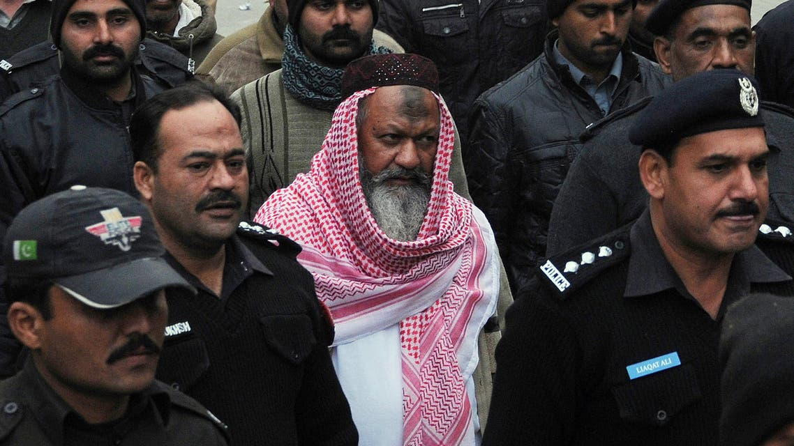 This file photo taken on December 22, 2014 shows Pakistani police escorting the head of banned Lashkar-e-Jhangvi (LeJ) Malik Ishaq (C), as he arrives at the high court in Lahore. AFP