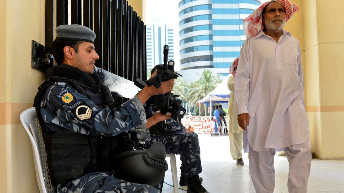 Kuwaiti police are on hand as worshippers arrive for Friday prayers at the Grand Mosque in Kuwait City on Friday, July 3, 2015, one week after a suicide attack by an ISIS sympathizer on Shiite worshippers. (AP)