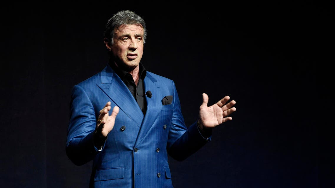 """FILE - In this April 21, 2015 file photo, Sylvester Stallone introduces a clip from the film """"Creed"""" at the Warner Bros presentation during CinemaCon 2015, at Caesars Palace, in Las Vegas. The actor performs as Rocky Balboa in """"Creed,"""" opening in Nov. 2015. (Photo by Chris Pizzello/Invision/AP, File)"""