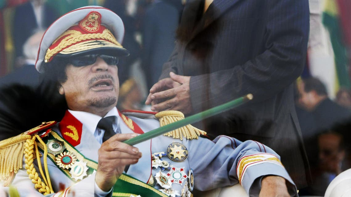 ap In this Tuesday, Sept. 1, 2009 file photo, Libyan leader Moammar Gadhafi gestures with a green cane as he takes his seat behind bulletproof glass for a military parade in Green Square, Tripoli, Libya.