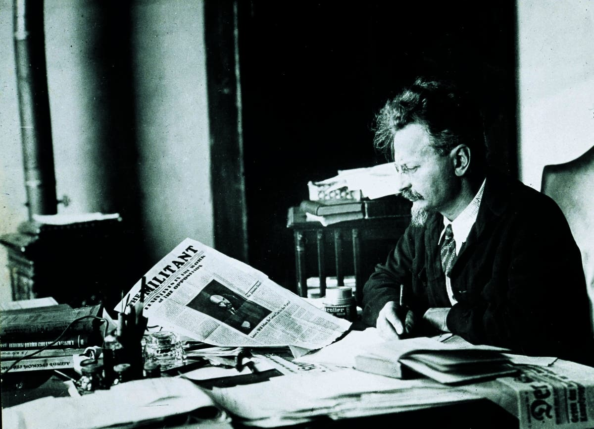 Trotsky reads a newspaper while sitting at his desk at his Turkish home in 1931. (Photo courtesy of Myjewishlearning.org)