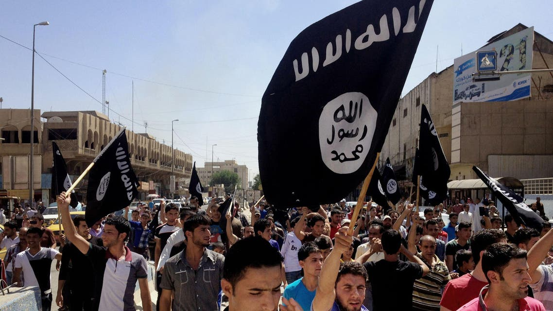 FILE - In this June 16, 2014 file photo, demonstrators chant pro-Islamic State group, slogans as they carry the group's flags in front of the provincial government headquarters in Mosul, 225 miles (360 kilometers) northwest of Baghdad. ISIS placed eighth on Google's list of 2014's fastest-rising global search requests, the company said Tuesday, Dec. 16, 2014. (AP Photo, File)