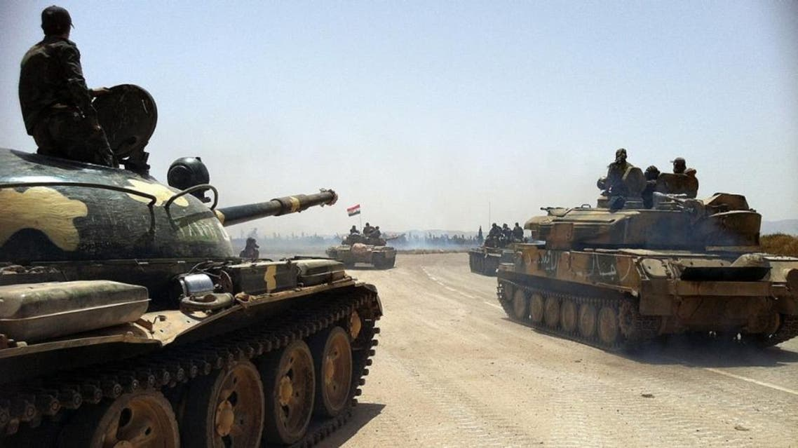 This photo taken by mobile phone on June 2, 2013 shows Syrian army tanks making their way to the Dabaa military airfield, north of the Syrian city of Qusayr.AFP/Getty Images
