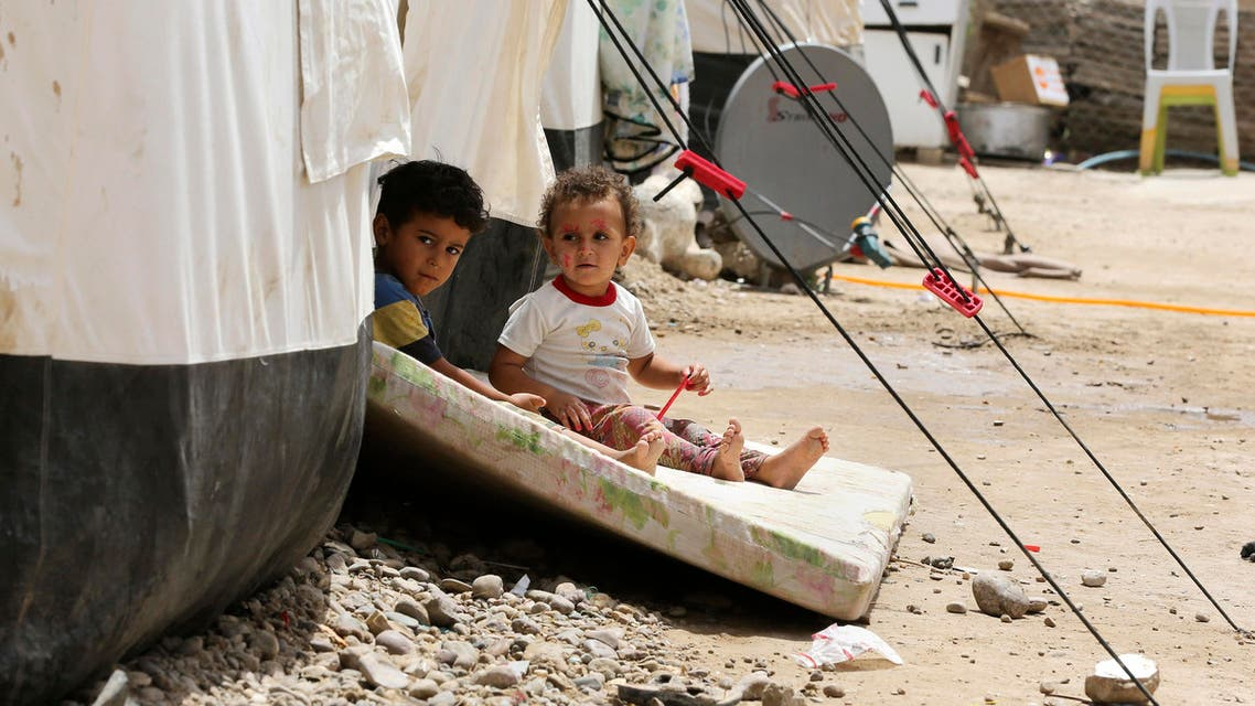 Iraqis children play outside a tent at a camp for displaced people in the al-Shurta neighborhood of west Baghdad, Iraq, Saturday, June 20, 2015. (AP)
