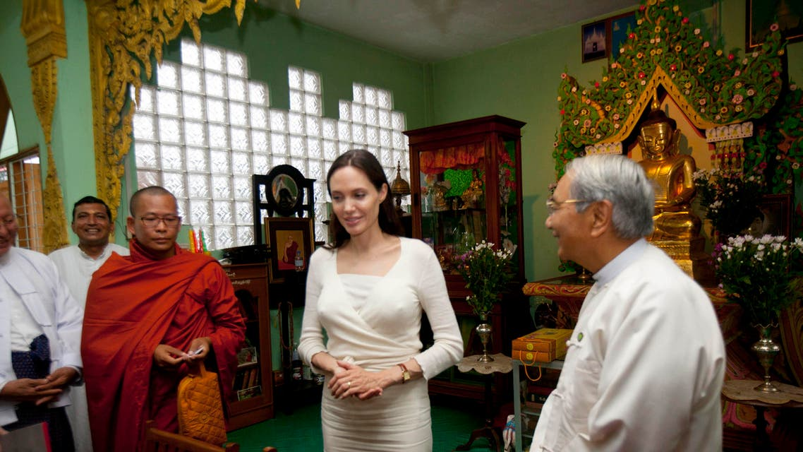 Angelina Jolie, center, is greeted by an Indian girl during a meeting with religious leaders from Myanmar Interfaith Group at a monastery Friday, July 31, 2015,