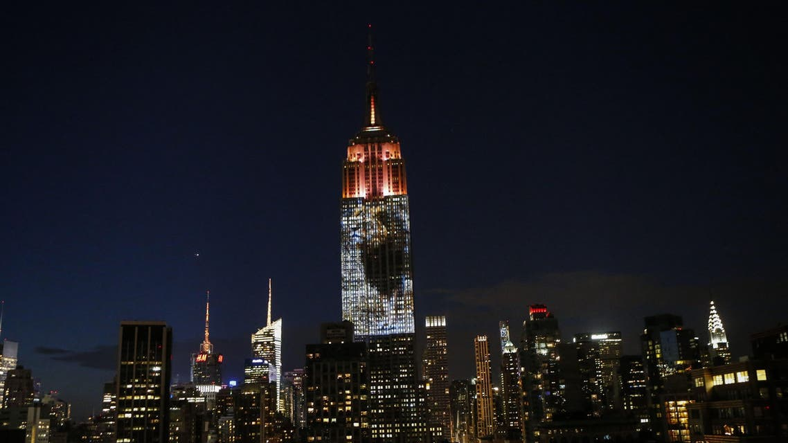 KB01 - New York, New York, UNITED STATES : Cecil the lion from Zimbabwe that was killed by an American Dentist is projected on the Empire State Building, in the 'Projecting Change on the Empire State Building' project, made by the Oscar winning director and founder of Oceanic Preservation Society Louis Psihoyos and producer Fisher Stevens in New York on August 1, 2015. PHOTO/ KENA BETANCUR