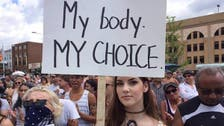 Topless protest in Canada urges women to 'Bare With Us'