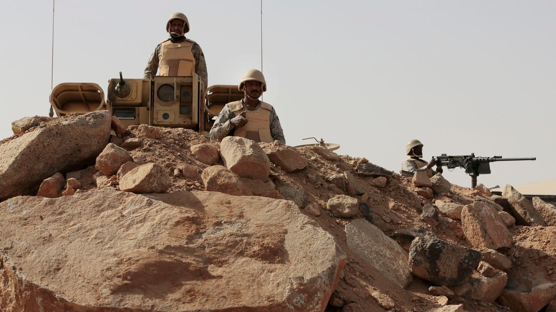 In this Tuesday, April 21, 2015 file photo, Saudi soldiers stand on top of armor vehicles, on the border with Yemen at a military point in Najran, Saudi Arabia. AP