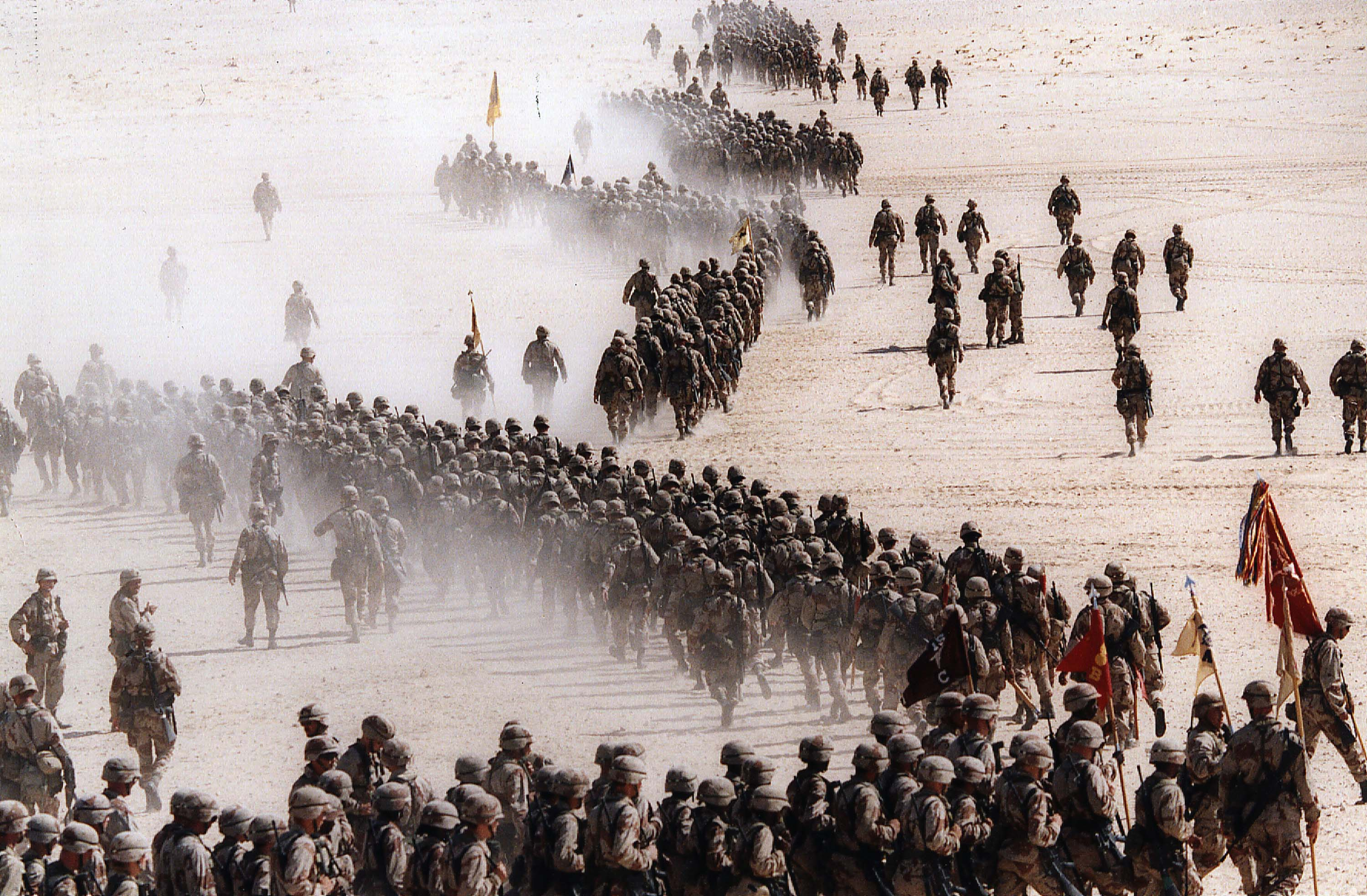 Responding to Iraq's invasion of Kuwait, troops of the U.S. 1st Cavalry Division deploy across the Saudi desert Nov. 4, 1990 AP