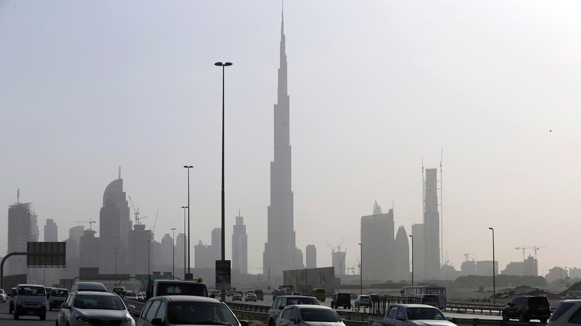 Cars pass by the city skyline with the Burj Khalifa, world tallest tower in background, Tuesday, July 28, 2015, in Dubai, United Arab Emirates. (AP)