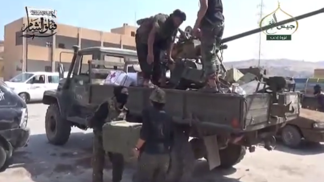 Syrian rebels seen loading supplies onto a truck in the northwestern Hama province (Video grab)