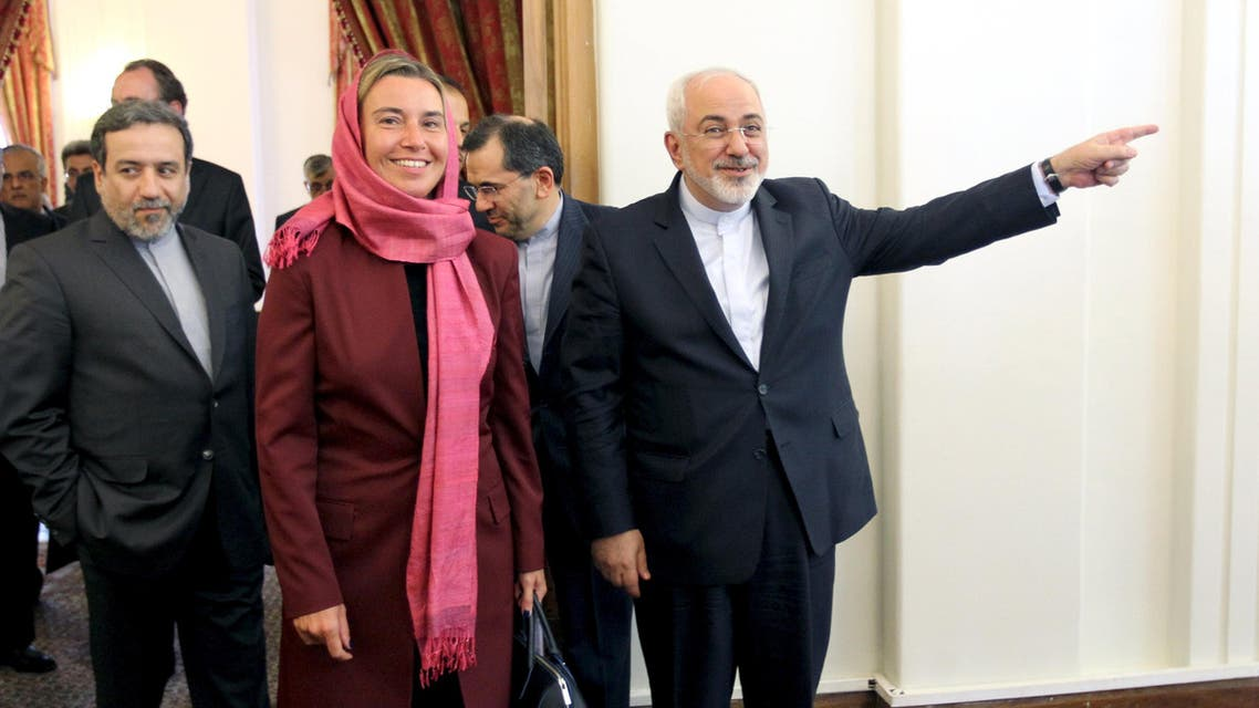 Iran's Foreign Minister Zarif, European Union foreign policy chief Mogherini and Iran's chief nuclear negotiator Araghchi arrive for meeting in Tehran. (Reuters)