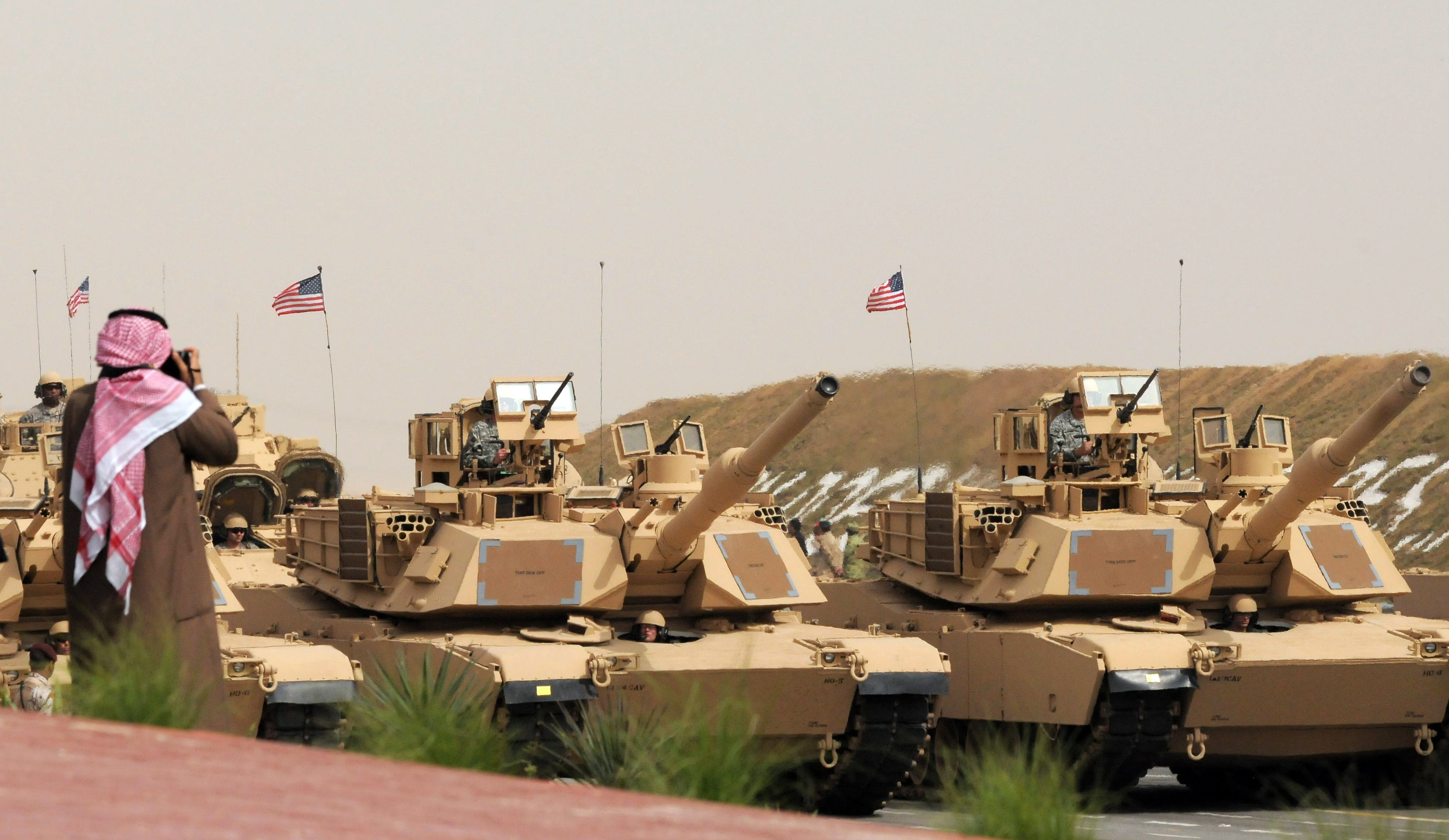 U.S. Army heavy battle tanks are seen during a military parade commemorating the 20th anniversary of the liberation of Kuwait from the 1990 Iraqi invasion. (AP)