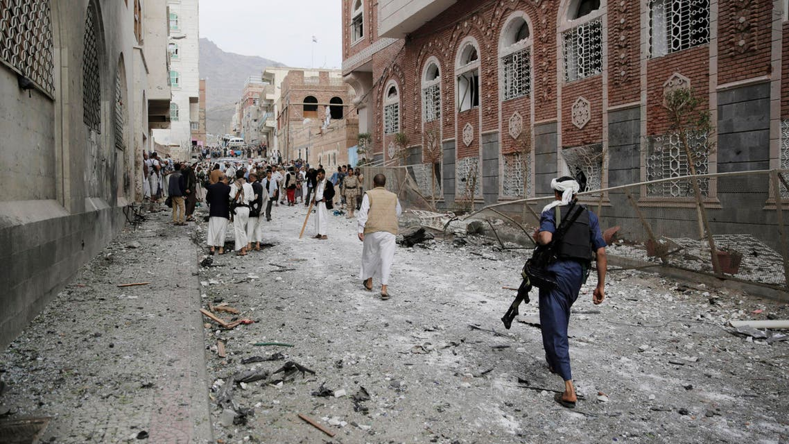 Shiite fighters known as Houthis gather at the site of a car bomb attack next to a Shiite mosque in Sanaa, Yemen, Wednesday, July 29, 2015. The car bomb exploded in Sanaa, next to a mosque belonging to the minority al-Bohra community, a Shiite sect, killing a few people and wounding several, Yemen's rebel-held Interior Ministry said in a statement. (AP Photo/Hani Mohammed)