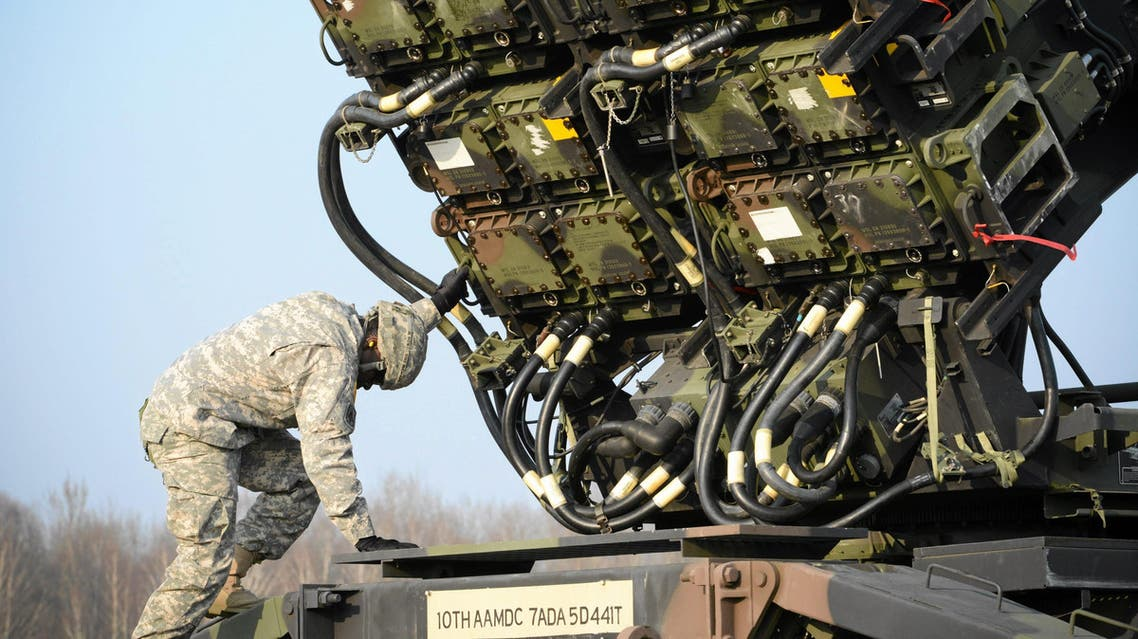 A U.S soldier inspecys a Patriot missile defence battery during join exercises at the military grouds in Sochaczew, near Warsaw, March 21, 2015.