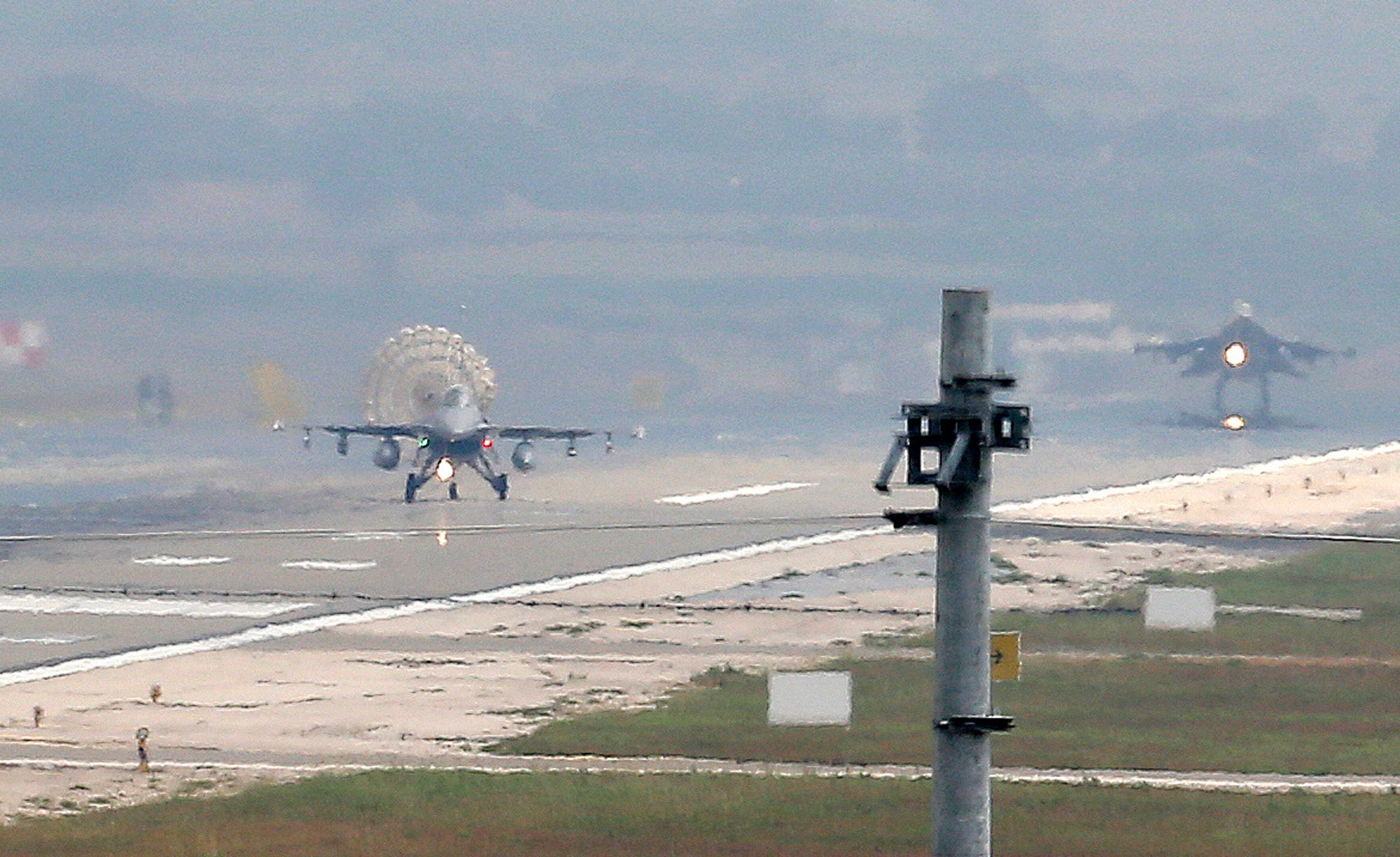 Turkish Air Force fighter planes land at Incirlik Air Base, on the outskirts of the city of Adana, southern Turkey, Thursday, July 30, 2015. After months of reluctance, Turkish warplanes last week started striking militant targets in Syria and agreed to allow the U.S. to launch its own strikes from Turkey's strategically located Incirlik Air Base. In a series of cross-border strikes, Turkey has not only targeted the IS group but also Kurdish fighters affiliated with forces battling IS in Syria and northern Iraq and Kurdistan Workers' Party, or PKK positions within Turkey. (AP Photo/Emrah Gurel)