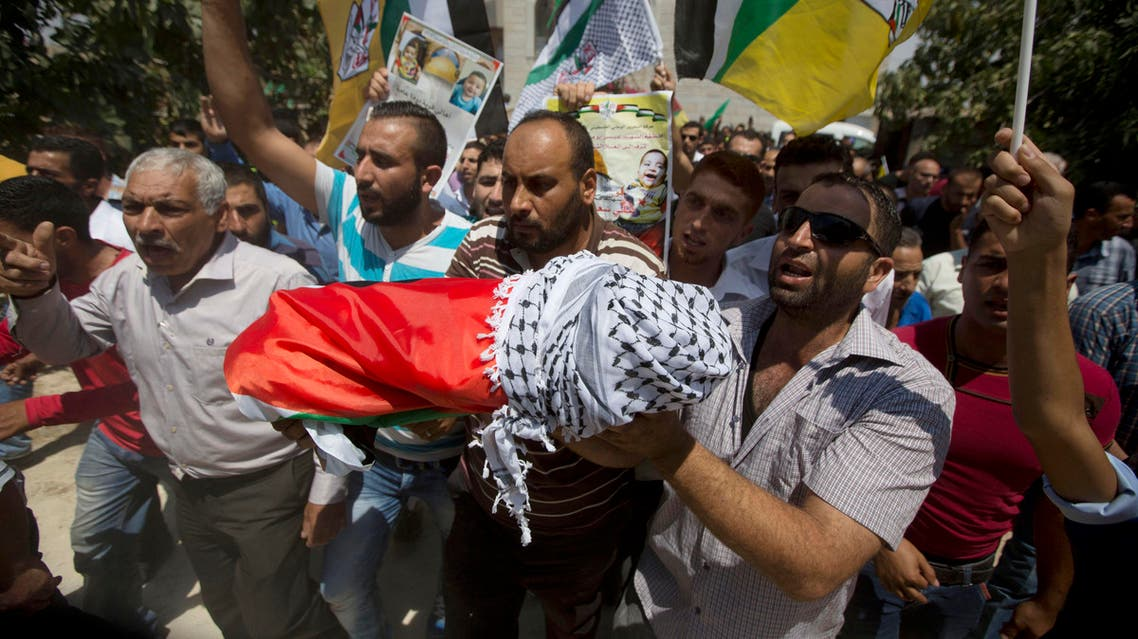 Palestinians carry the body of one-and-a-half year old boy, Ali Dawabsheh, during his funeral in Duma village near the West Bank city of Nablus, Friday, July 31, 2015. The sleeping toddler was burned to death when suspected Jewish assailants set fire to two Palestinian homes in a West Bank village early Friday, an attack that also critically wounded the child's 4-year-old brother and parents and outraged both Israelis and Palestinians. (AP Photo/Majdi Mohammed)