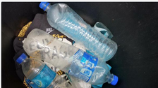 MH370 officials investigating water bottles found on La Reunion