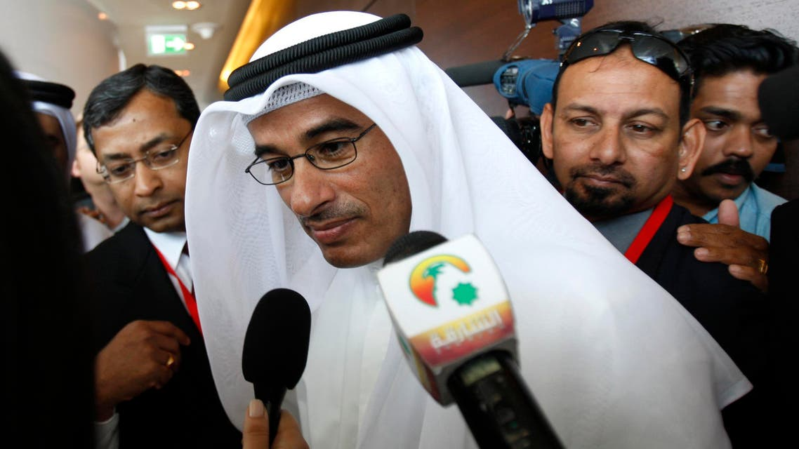 Emaar Properties chairman Mohammed Alabbar talks to the journalists at the Observation Deck of the Burj Dubai, the world's tallest building in Dubai, United Arab Emirates, shortly before the official opening of the building Monday, Jan. 4, 2010. Burj Dubai is over 800 metres (2,625 ft) tall and has more than 160 stories, the most of any building in the world and has an observation deck on its 124th floor with 360-degree views of the entire city. The Burj Dubai is home to the world's first Armani Hotel, luxury offices and residences and will ultimately be the place of residence, work and leisure for a possibly encapsulated community of up to 12,000 people. (AP Photo/Kamran Jebreili)