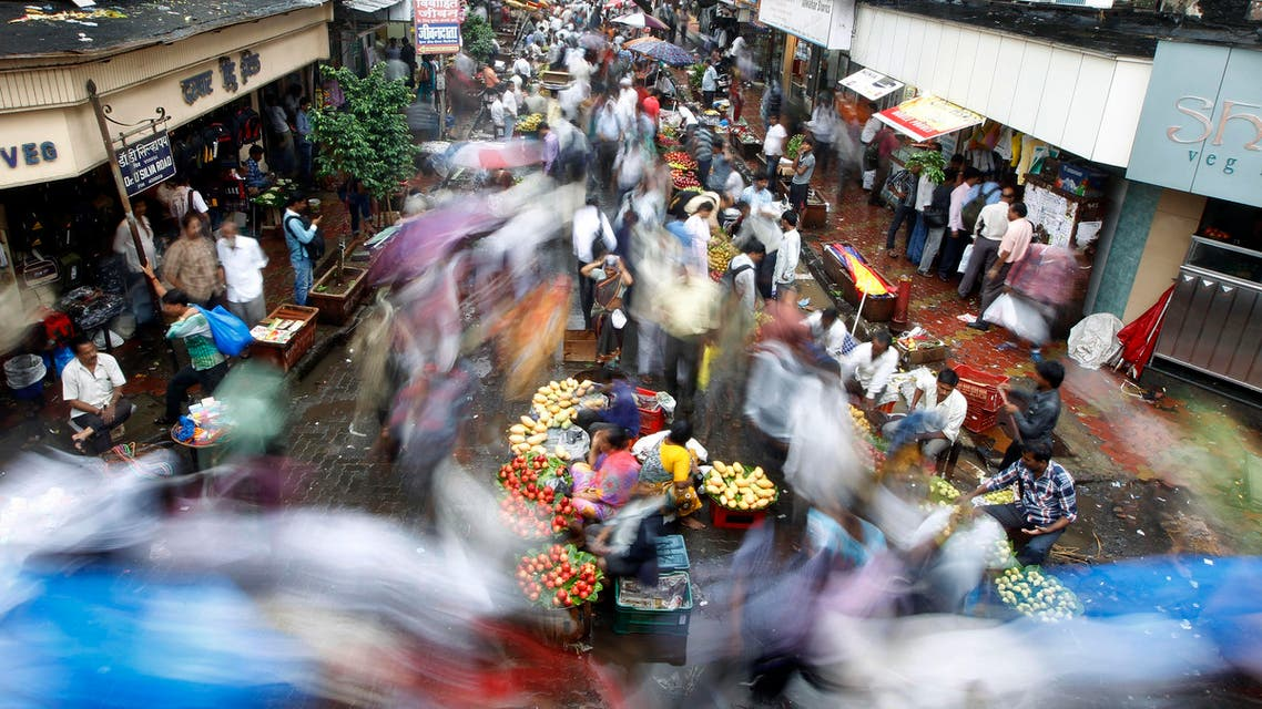 A crowd swarms a market area near a train station on World Population Day in Mumbai, India, Thursday, July 11, 2013.(AP Photo/Rajanish Kakade)