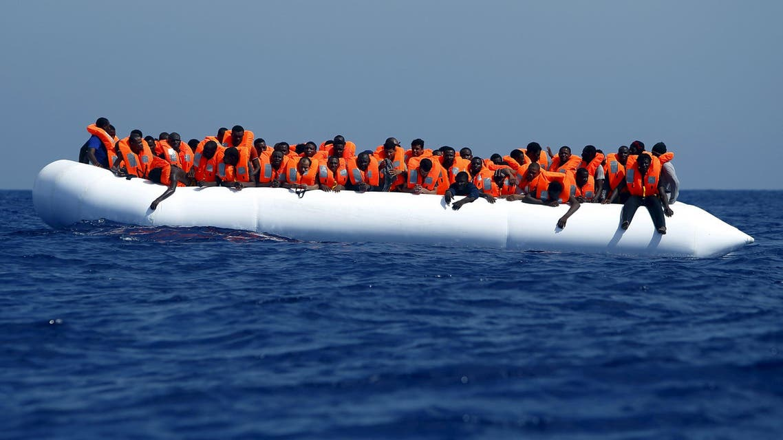 Migrants on a rubber dinghy wait to be rescued by the Migrant Offshore Aid Station (MOAS) ship MV Phoenix, some 20 miles (32 kilometres) off the coast of Libya, August 3, 2015.  (Reuters)