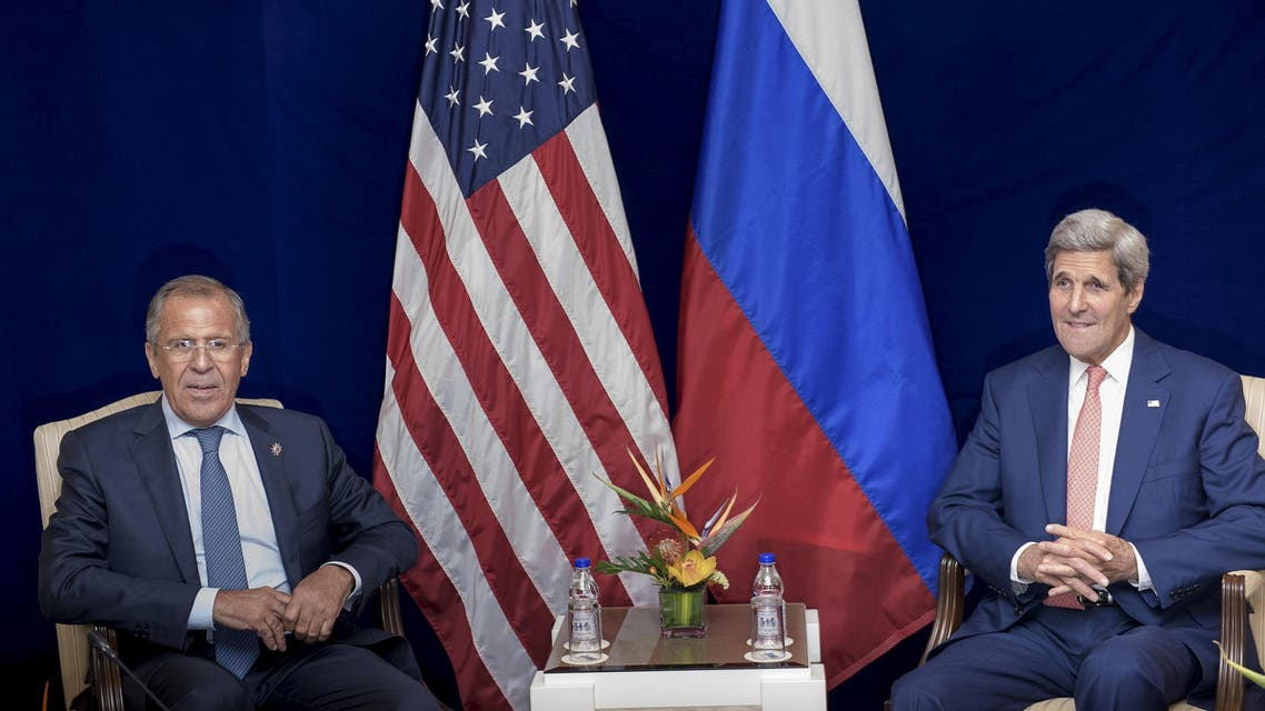 Russia's Foreign Minister Sergei Lavrov (L) and U.S. Secretary of State John Kerry sit next to each other before a bilateral meeting in Kuala Lumpur, Malaysia August 5, 2015. Kerry met for a second time in three days on Wednesday with Lavrov, who has been trying to bring about a rapprochement between Syria and regional states to forge an alliance to fight Islamic State militants. REUTERS/Brendan Smialowski/Pool