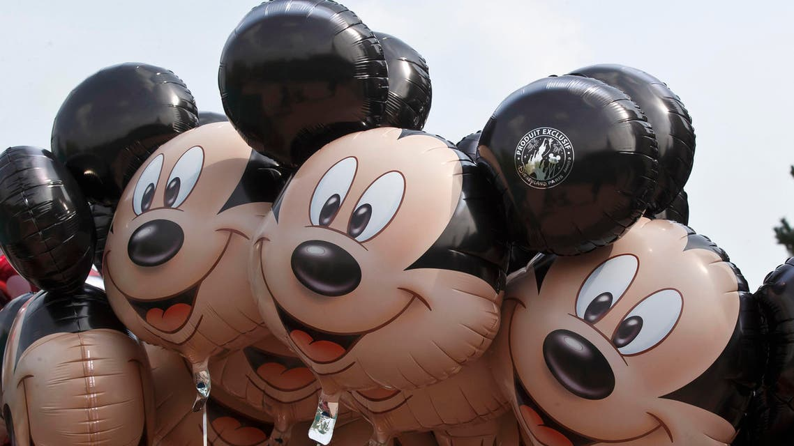 Ballons featuring Mickey Mouse are seen at Disneyland Paris, in Chessy, France, est of Paris, Tuesday, May 12, 2015. (AP)