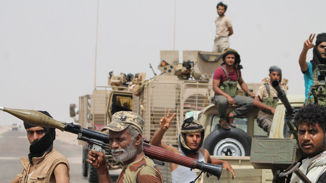 In this photo taken Monday, Aug. 3, 2015, fighters against Shiite rebels known as Houthis gather at the road leading to Al-Anad base near Aden in the southern province of Lahej, Yemen. The capture of the Al-Anad base was a significant victory for the forces allied to Yemen's exiled President Abed Rabbo Mansour Hadi in their battle to reverse the gains of Houthis. (AP)