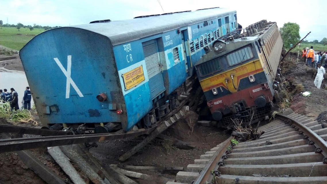 TRA001 - Harda, MADHYA PRADESH, INDIA : Two Indian passenger trains lay next to each other following a derailment after they were hit by flash floods on a bridge outside the town of Harda in Madhya Pradesh state on August 5, 2015. Two passenger trains derailed after being hit by flash floods on a bridge in central India, killing at least 27 people in the latest deadly accident on the nation's crumbling rail network. AFP PHOTO