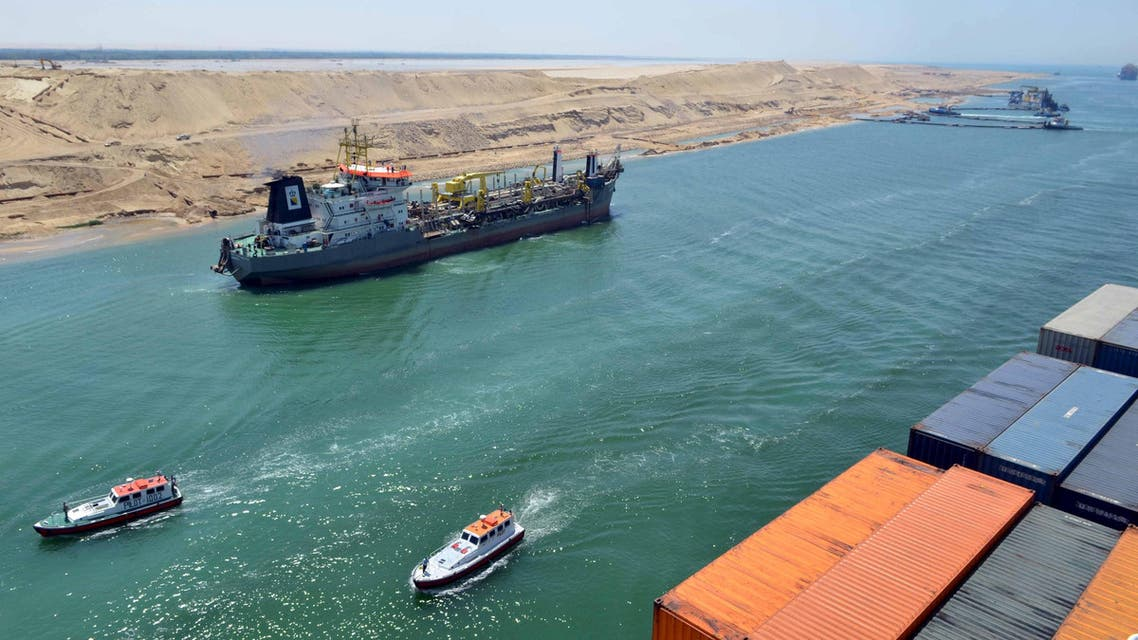 A cargo ship is seen crossing through the New Suez Canal