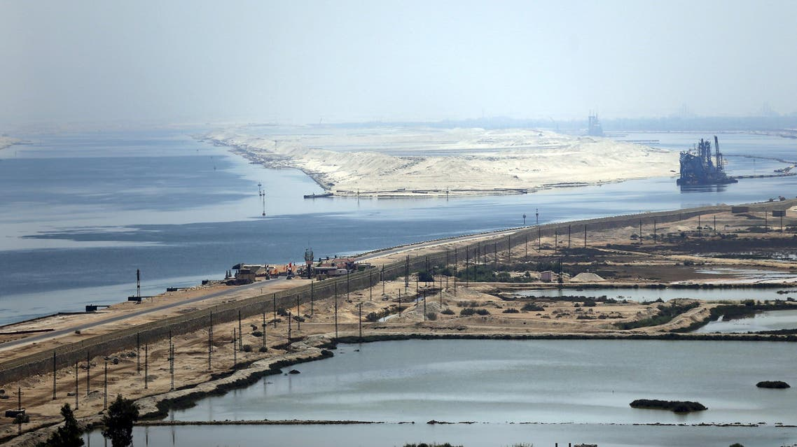 """A general view of the Suez Canal from Al Salam """"Peace"""" bridge on the Ismalia desert road before the opening ceremony of the New Suez Canal, in Egypt, August 6, 2015. Egypt will open an expansion to the Suez Canal to great fanfare on Thursday, the centrepiece of President Abdel Fattah al-Sisi's plans to revitalise the country's economy after years of damaging political turmoil. REUTERS/Amr Abdallah Dalsh"""